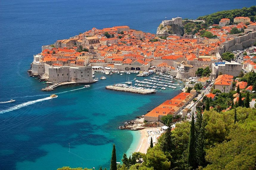 Among hot new destinations for Chinese travellers abroad is Dubrovnik in Croatia (top), while popular activities include safaris to view elephants in Kenya and sunbathing at Copacabana in Rio de Janeiro. Chinese tourists now want to spend more time s