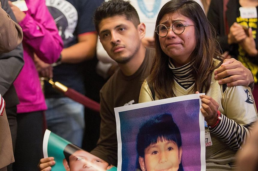 Mr Jario Reyes, 25, and Ms Karen Caudillo, 21, with photos of their younger selves at a press conference on Capitol Hill in Washington on Wednesday. They are Dreamers, or beneficiaries of the Obama-era programme which is set to be phased out from nex
