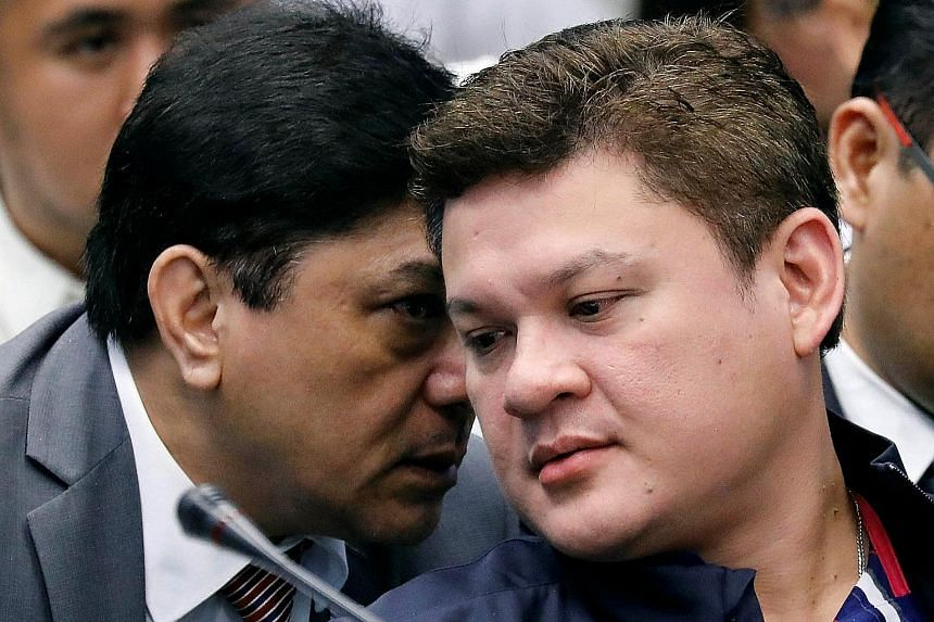 Mr Paolo Duterte (right) listening to his lawyer at the hearing yesterday on a $168.5 million drug shipment.