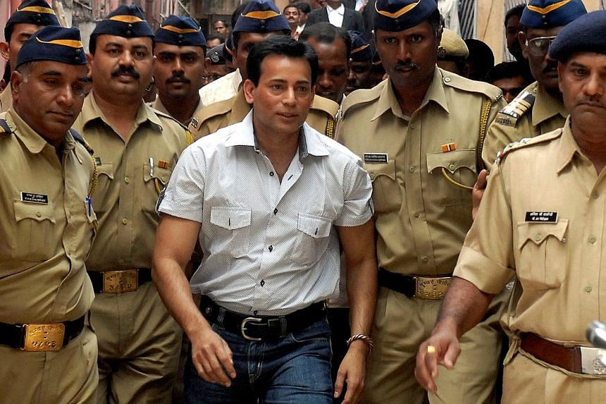 A 2007 picture of Abu Salem arriving at a court in the southern city of Hyderabad. He was sentenced to life imprisonment yesterday instead of the death penalty as that was the condition set by a Lisbon court before it allowed his extradition from Por