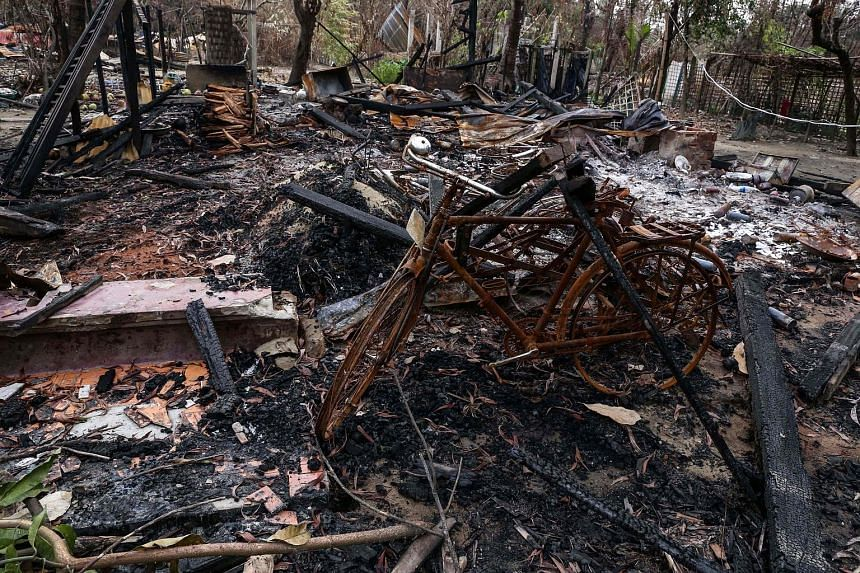 Top: The remains of houses burned allegedly by Rohingya militants in Maungdaw township, Rakhine state, as seen on Wednesday. Above: Rohingya insurgent leader Ata Ullah in a Skype interview with Reuters in Yangon in March.
