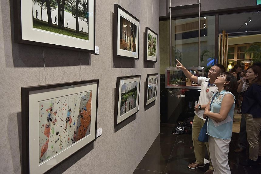 A collection of photographs shot by Straits Times photojournalists Neo Xiaobin and Kua Chee Siong is on show at the Leica Gallery at the Fullerton Hotel. In a collaboration between ST and Leica, the two photojournalists took to the streets - armed wi