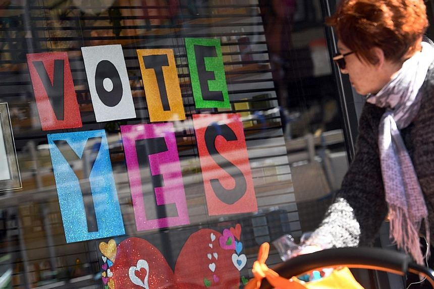 A sign in a shop window supporting same-sex marriage in Sydney. Australians will begin voting in the non-compulsory ballot as early as next week, with a result expected some time in November.