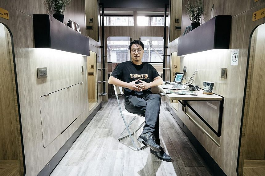 Synergy Biz Group co-founder Keith Wong inside a room at the company's Bibliotheque co-living development in Yau Ma Tei. A single room of about 400 sq ft in the development may sleep as many as 10 people.