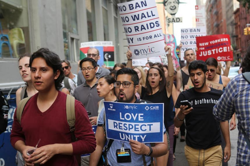 Protesters chant slogans against US President Donald Trump's limited travel ban, approved by the US Supreme Court, in New York City on June 29, 2017.