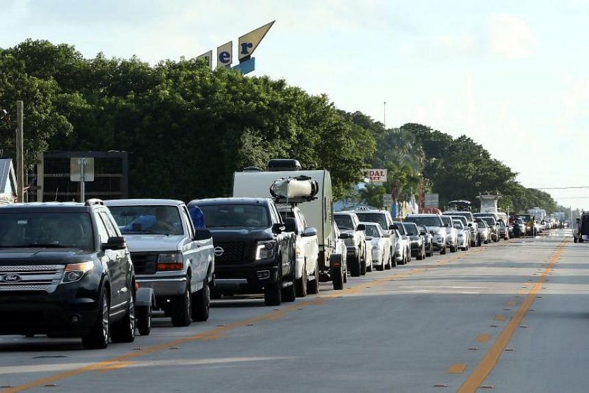 Cars sit in traffic as they evacuate heading north on Overseas Highway in the Florida Keys on Sept 5, 2017.