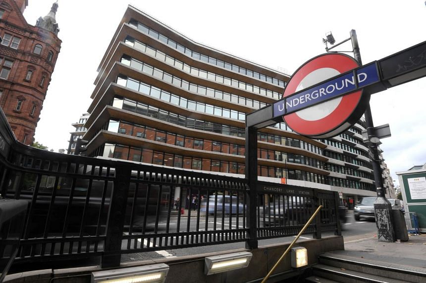 An office building housing the London headquarters of PR company Bell Pottinger is seen behind an entrance to an underground train station in London.