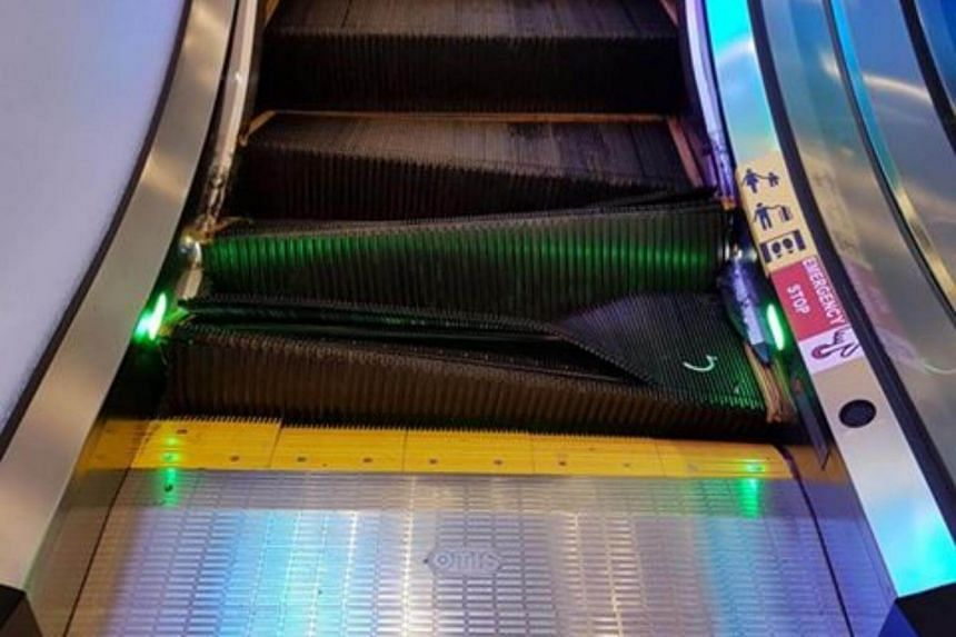 The escalator steps at The Centrepoint shopping mall buckled and collapsed inwards at the bottom of the flight.