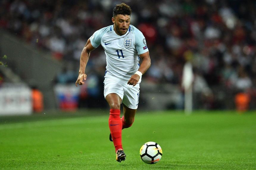 England's midfielder Alex Oxlade-Chamberlain runs with the ball during the World Cup 2018 qualification football match between England and Slovakia at Wembley Stadium in London on Sept 4, 2017.