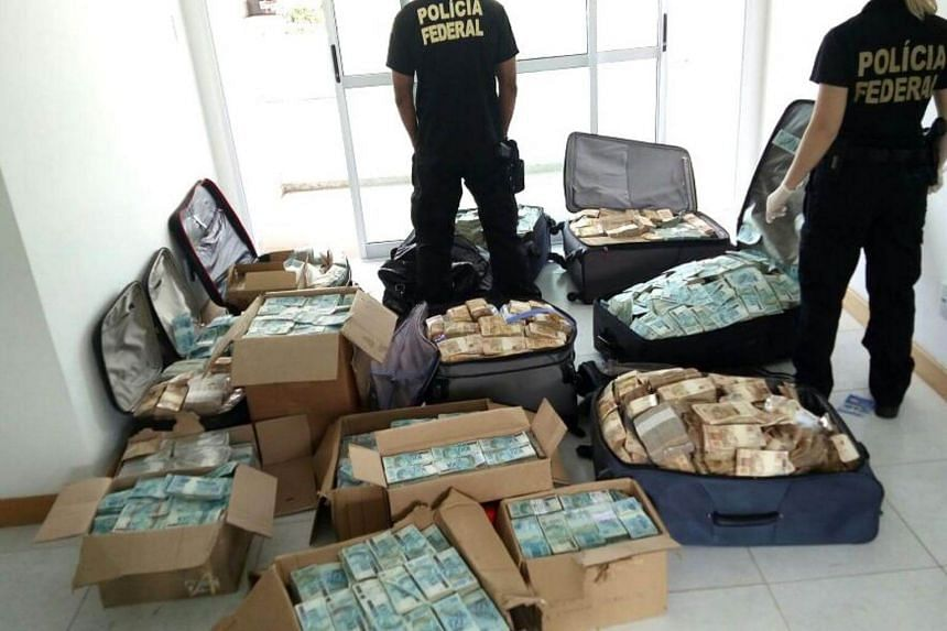 Boxes and suitcases filled with money that were found by authorities at an apartment that was used by former minister Geddel Vieira Lima.