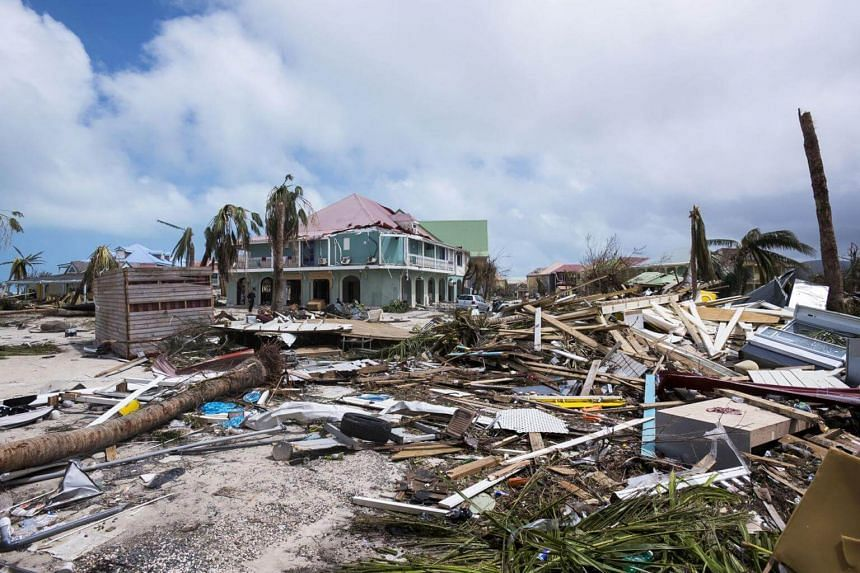 A photo taken shows the damage in Orient Bay on the French Carribean island of St Martin, after the passage of Hurricane Irma on Sept 7, 2017.