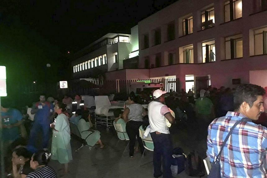 Patients and doctors of a hospital in Villahermosa, Mexico, remain outdoors after the earthquake.