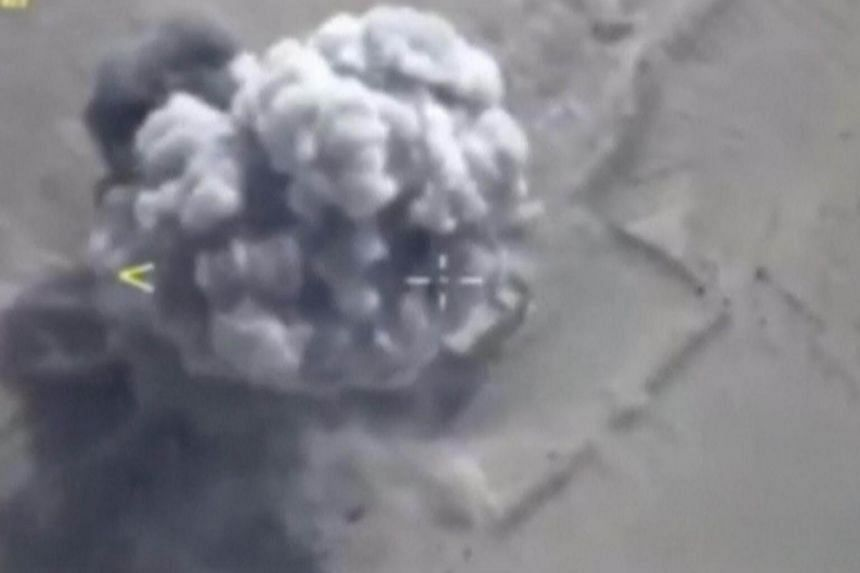 A still image taken from a video footage and released by Russia's Defence Ministry on Sept 5, 2017, shows airstrikes, carried out by the Russian frigate Admiral Essen and hitting what the Defence Ministry says was an Islamic State target, in Deir al-