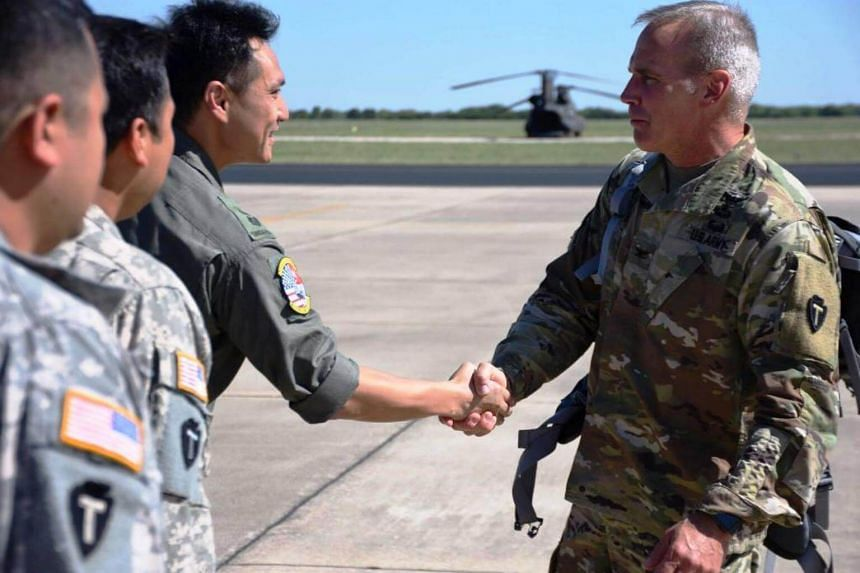 TXARNG State Aviation Officer, Colonel Ronald Burkett (right), thanking RSAF's Peace Prairie Detachment Commander, Lieutenant-Colonel Howe Siong Sen (third from left), for the RSAF's contributions to the relief operations for Hurricane Harvey.