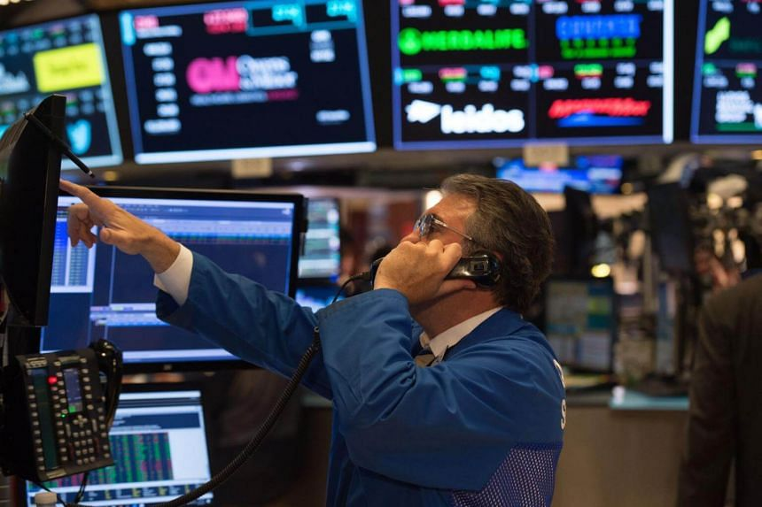 A trader working on the floor at the closing bell of the Dow Industrial Average at the New York Stock Exchange.