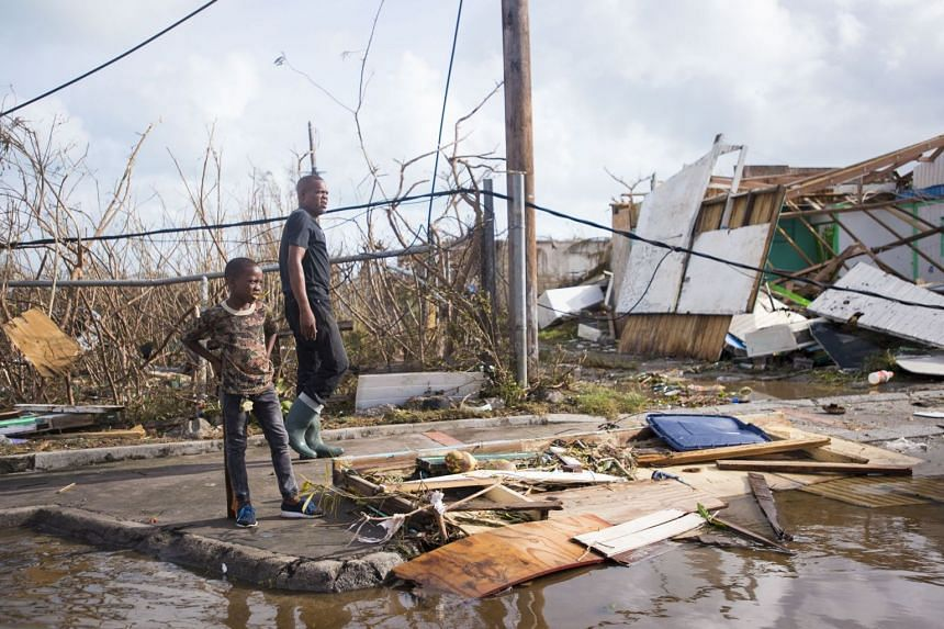 People check out the damage caused by Irma in Marigot, on the island of Saint-Martin in the north-east Caribbean.