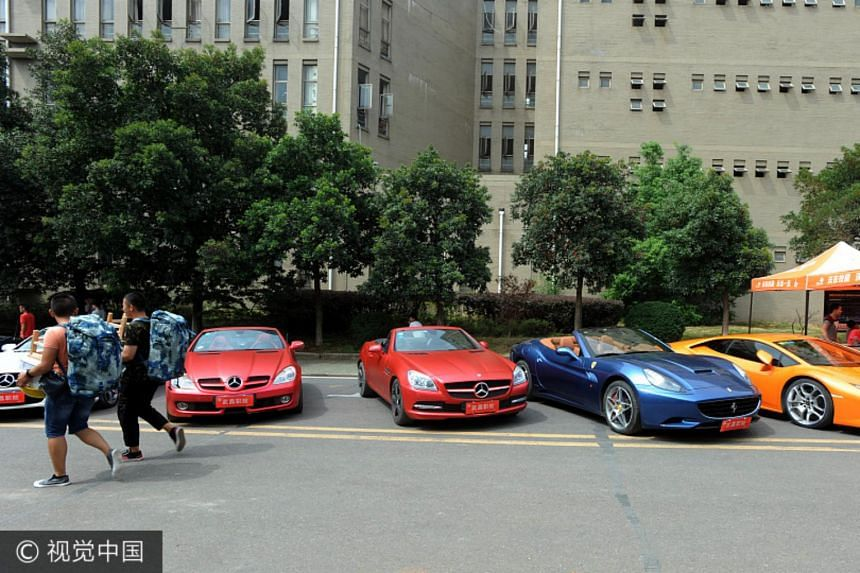 Twenty luxury cars, including Maserati, Ferrari and Porsche, are parked at the campus of Wuchang Polytechnic College in Hubei province to welcome its freshmen, on Sept 5, 2017.