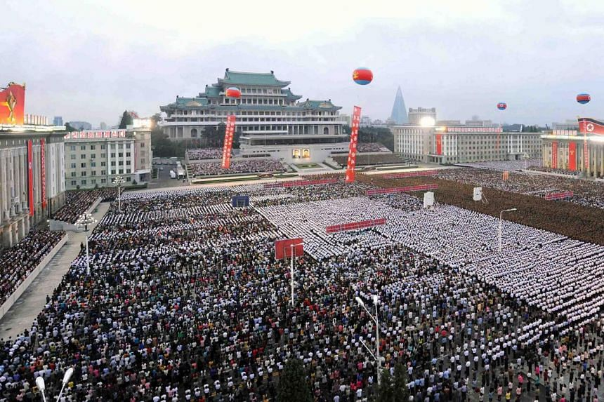 Pyongyang residents and military people holding a celebration rally on the test of a hydrogen bomb for ICBM at Kim Il Sung Square in Pyongyang on Sept 6, 2017.