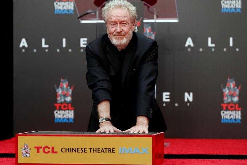 Director Ridley Scott places his hands in cement during a ceremony in the forecourt of the TCL Chinese theatre in Los Angeles, California on May 17, 2017.