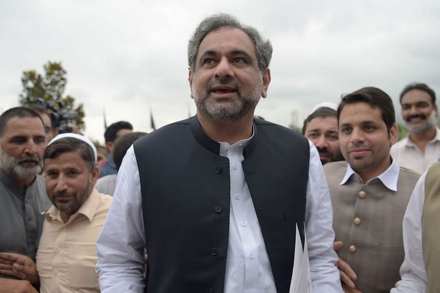 Pakistan's former petroleum minister and prime minister-designate Shahid Khaqan Abbasi arrives at the Parliament House to casts his vote during the election for interim prime minister in Islamabad on Aug 1, 2017.