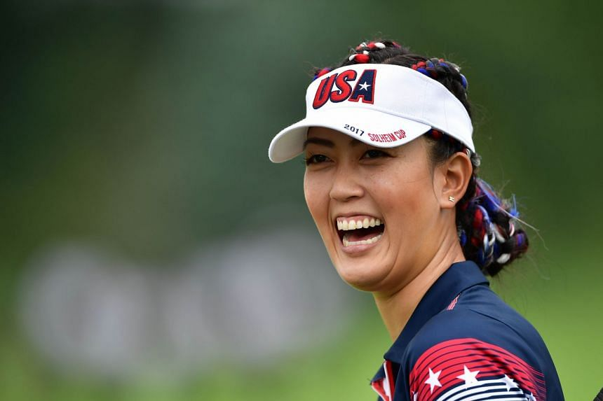 Michelle Wie laughs during practice for The Solheim Cup, Aug 16, 2017.