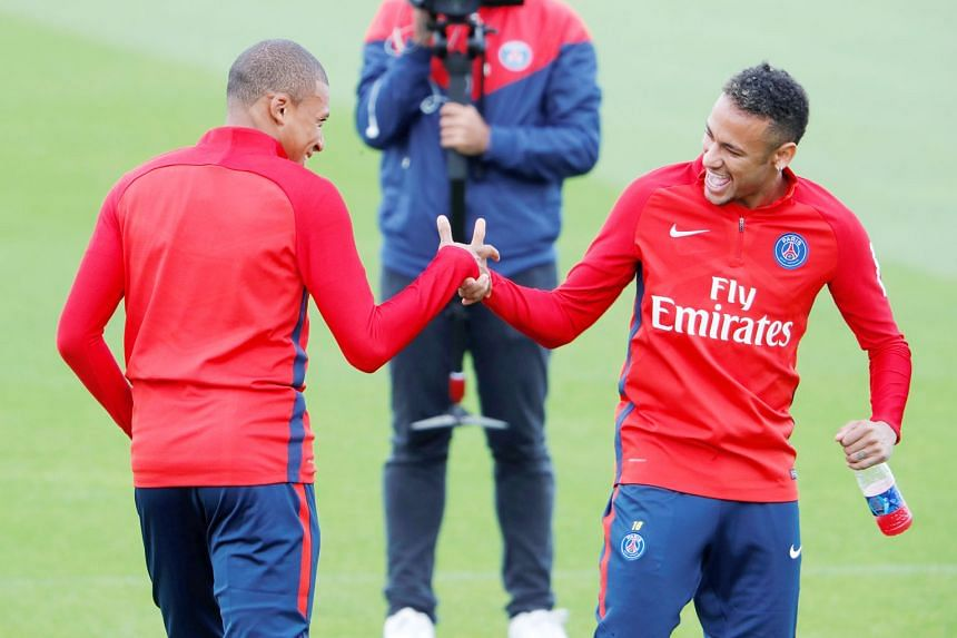 """Forwards Kylian Mbappe (left) and Neymar have been big signings for PSG, prompting LaLiga president Javier Tebas to accuse the French club's Qatari backers of """"financial doping""""."""