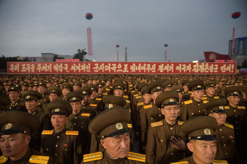 Korean People's Army (KPA) soldiers attend a mass celebration in Pyongyang for scientists involved in carrying out North Korea's largest nuclear blast to date, on Sept 6, 2017.