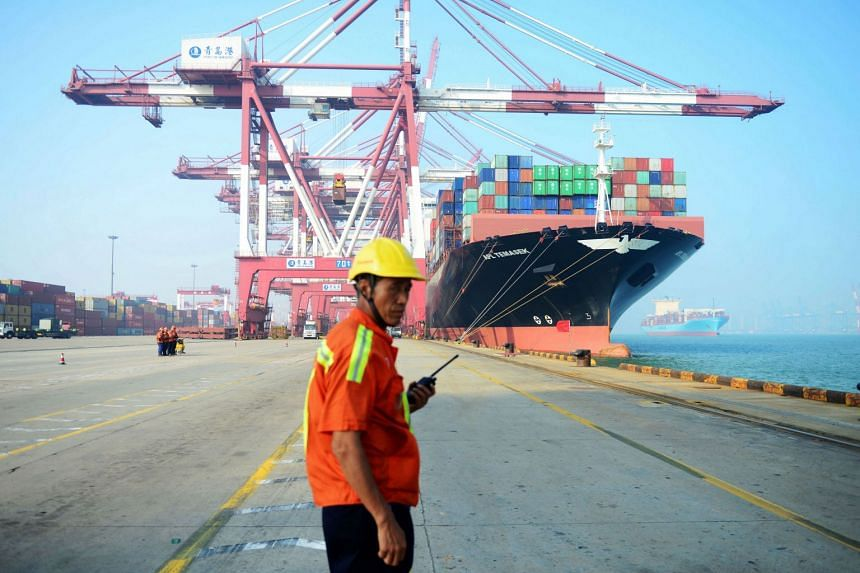 A Chinese worker at a port in Qingdao, eastern China's Shandong province, on July 13, 2017. China's export growth slowed as global demand for its products moderated, while imports remained robust as investment at home aided demand.