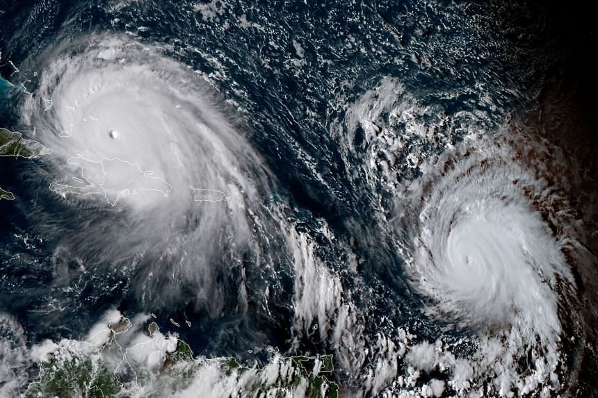 A satellite image shows Hurricane Irma (left) and Jose (right) on Sept 7, 2017.