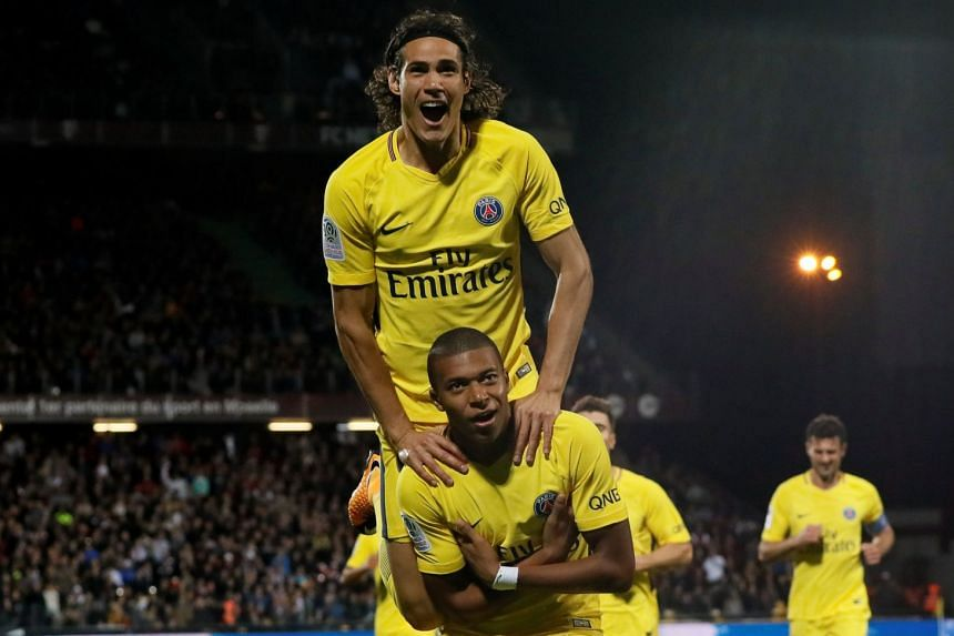 Kylian Mbappe celebrates scoring their second goal with Edinson Cavani.