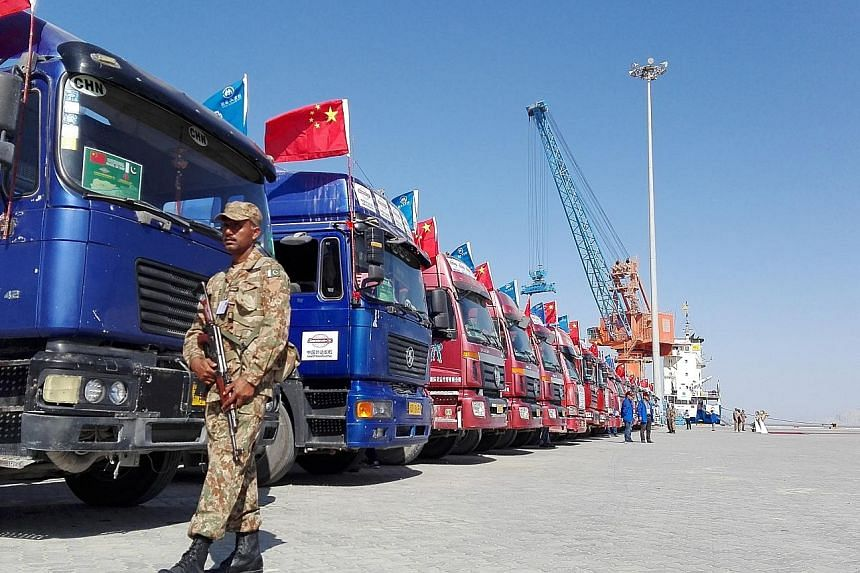 Chinese trucks at Pakistan's Gwadar port in Pakistan. Beijing's investments in the South Asian nation has grown, with China developing the port and the $73.6 billion China-Pakistan Economic Corridor.