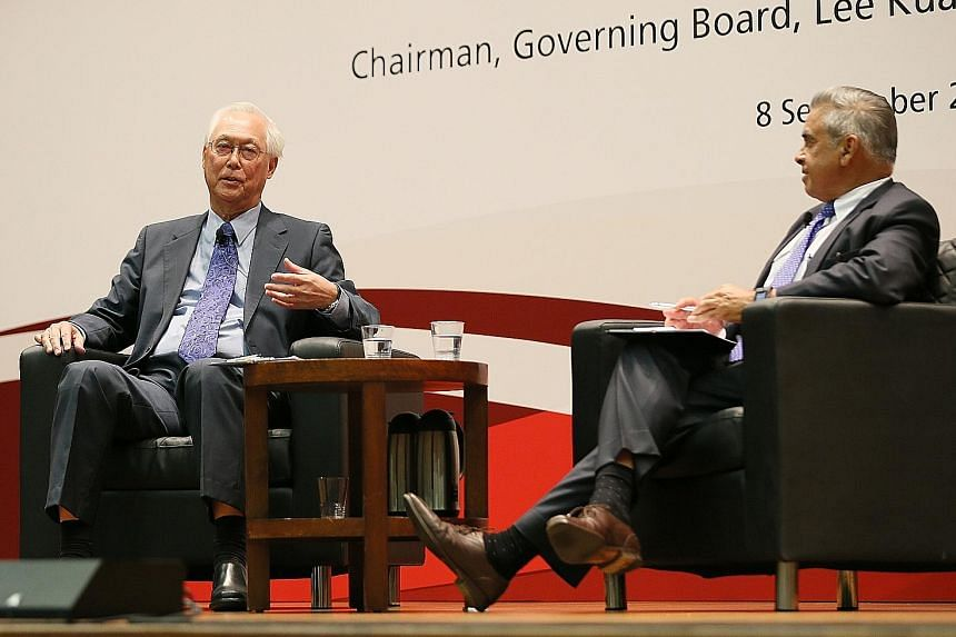 ESM Goh Chok Tong and Lee Kuan Yew School of Public Policy dean Kishore Mahbubani at a dialogue to mark the school's 13th anniversary yesterday. Mr Goh shared personal experiences, like how the 2003 Sars crisis was the most frightening challenge he f