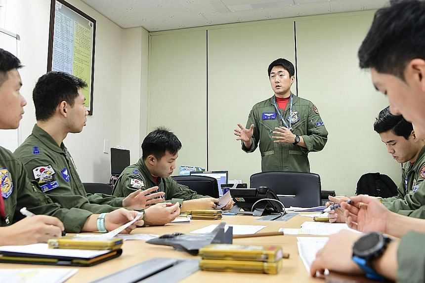South Korean fighter pilots being briefed before their exercise in Cheongju.