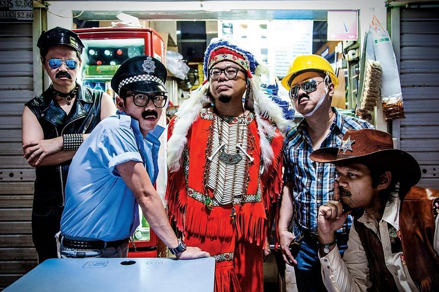 TypeWriter members (from far left) Robin Chua, Desmond Goh, Yee Chang Kang, Patrick Chng and Alan Bok wear costumes inspired by 1970s disco icons Village People for the Sorry, I Got Carried Away music video.