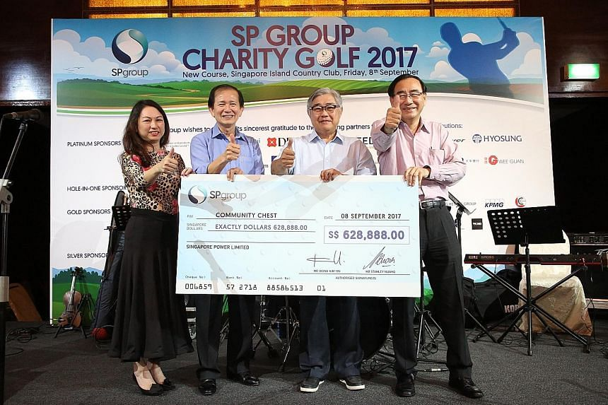 From left: Ms Catherine Teo, Mr Wong Chit Sieng, Mr Ong Yew Huat and Mr Phillip Tan with the cheque yesterday.