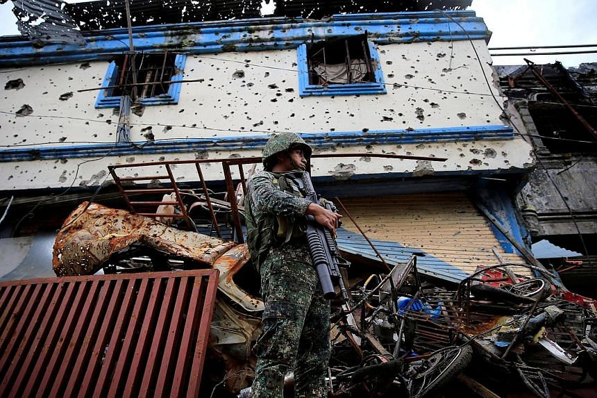 Marawi is a city riddled with battle scars as Philippine troops continue their assault on militants in the southern city. More than 800 extremists, government troops and civilians have been killed in the conflict, said the military.