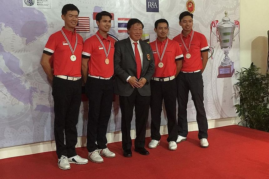 Murdaya Widyawimarta Poo, president of the Indonesia Golf Association, with the Singapore men's golf team in Jakarta. They finished second to Thailand in the Putra Cup for the second year running.