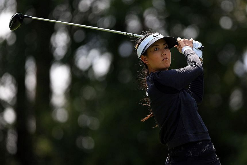 Michelle Wie playing a tee shot in round two of the Canadian Pacific Women's Open in Ottawa last month. She pulled out before the final round and has since had an appendix operation. She has now withdrawn from next week's Evian Championship.