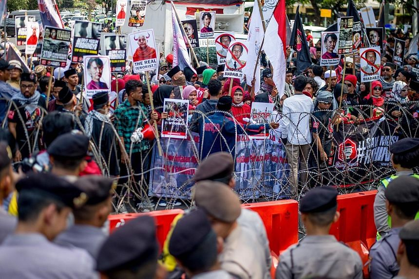 Demonstrators taking part in a rally outside the Myanmar Embassy in Jakarta yesterday, one of several protests that took place in Asian cities to condemn the violence in Myanmar's Rakhine state. Rohingya refugees living in Malaysia joining the protes