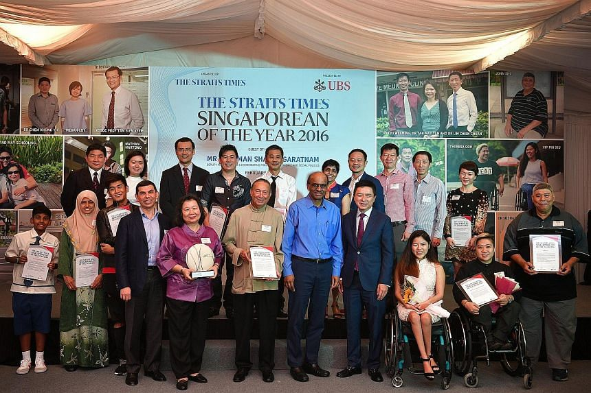 Parents May and Colin Schooling (fifth and sixth from left in front row), who won The Straits Times Singaporean of the Year 2016 together with their son Joseph (not pictured), with (from fourth left) Mr Warren Fernandez, ST editor and editor-in-chief