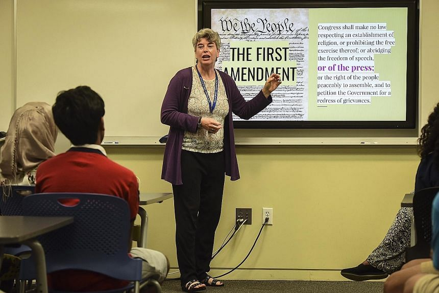 Ms Kim Ash teaching the Newseum's Fighting Fake News class. Teachers in the United States are increasingly concerned that their students will grow up not believing anything they read, or believing the difference between what is real and what is fake