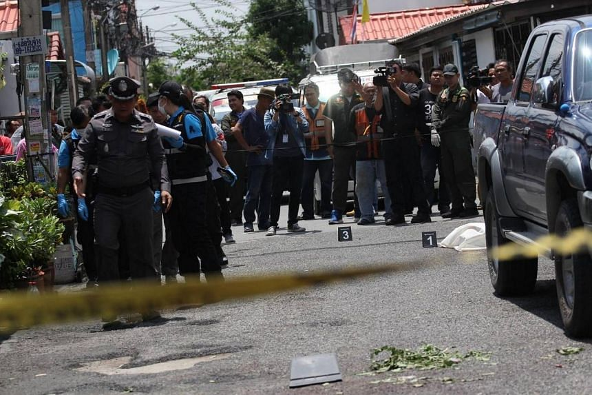 Somchai Klinhom, 47, was stabbed to death at his townhouse in the Maneemart housing estate in Bangkok's Khan Nayao district at 11.45am.