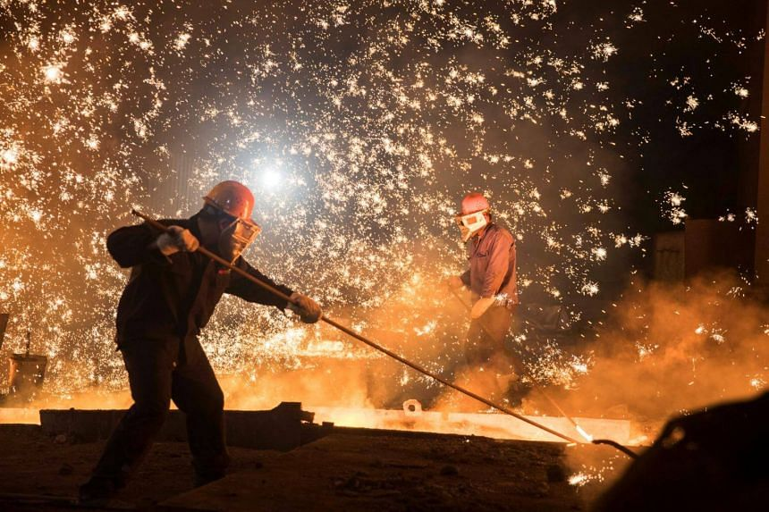 Laborers work at a steel plant of Shandong Iron & Steel Group in Jinan, Shandong province.