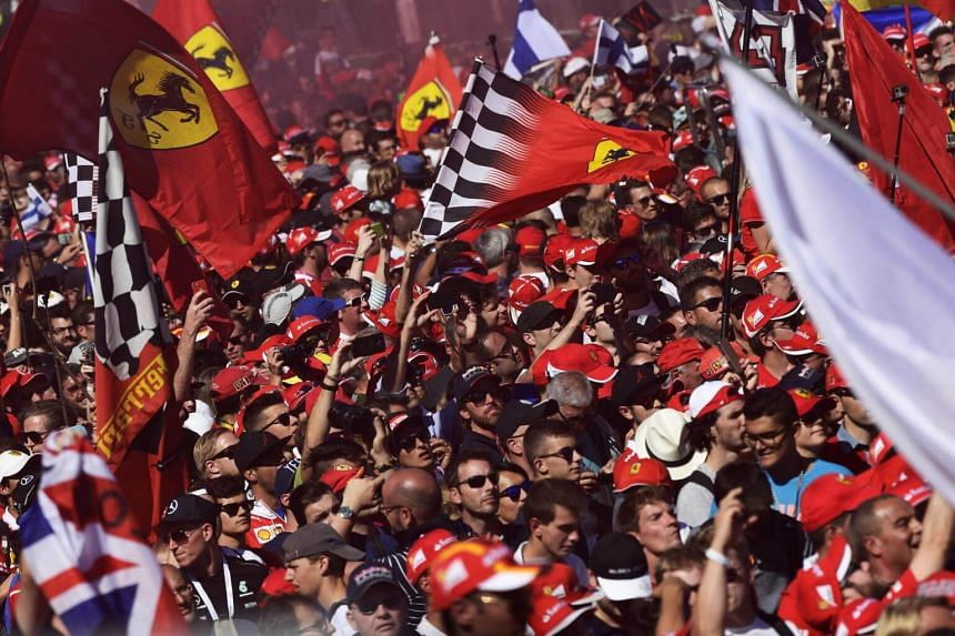 Fans celebrate after the Italian Formula One Grand Prix at the Autodromo Nazionale circuit in Monza on Sept 3, 2017.