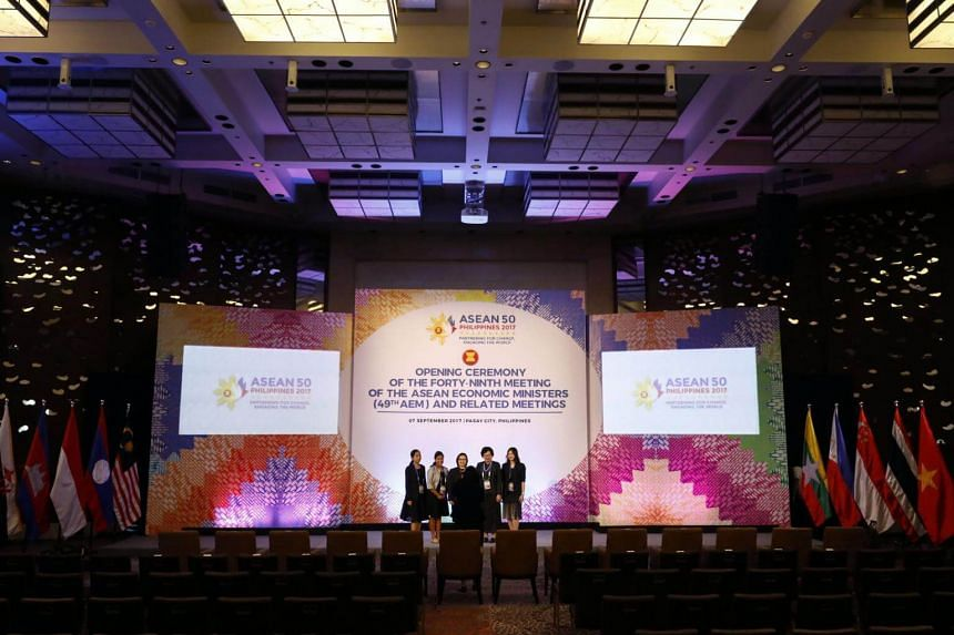Delegates take photographs during the opening ceremony of the 49th Asean Economic Ministers Meeting and Related Meetings at the Mariott Hotel in Pasay City.