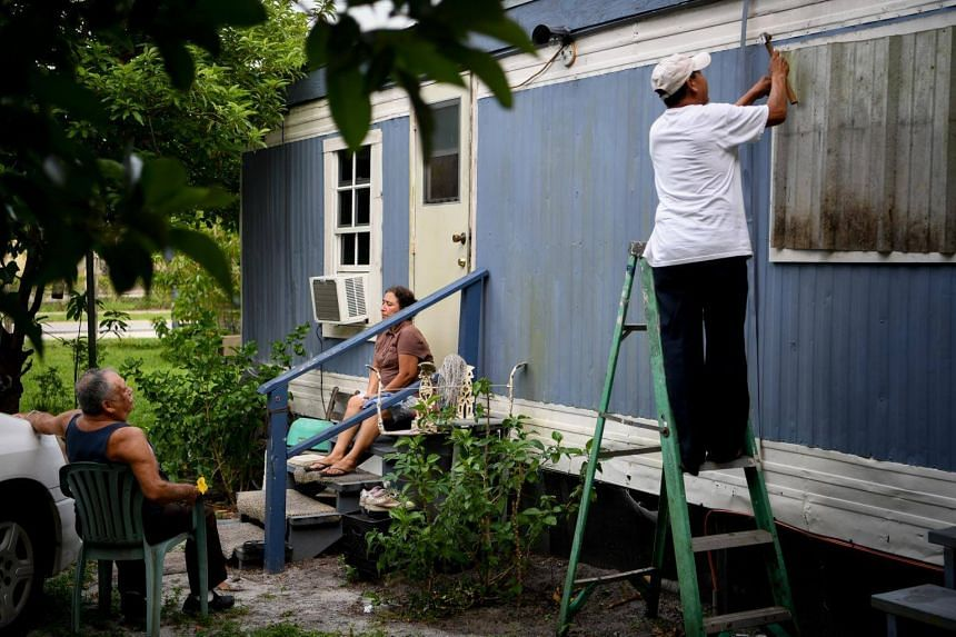 Residents use scavenged materials to protect their home in preparation for Hurricane Irma in Immokalee, Florida, US on Sept 8, 2017.