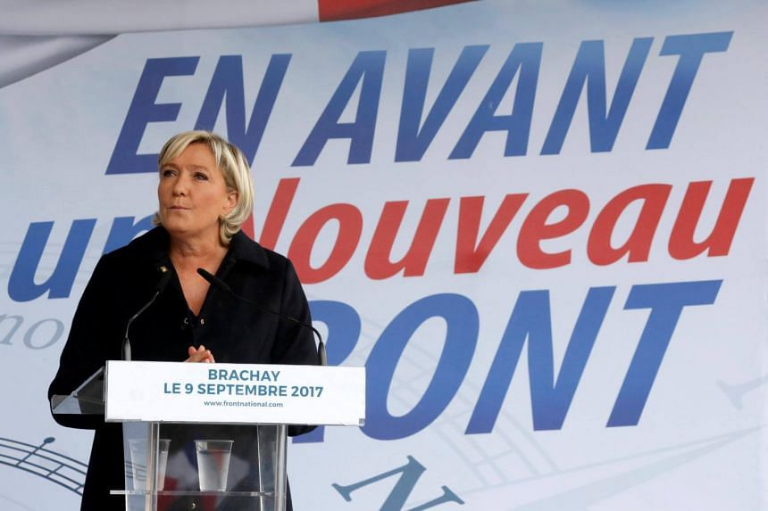 Member of parliament Marine Le Pen of France's far-right National Front (FN) political party delivers a speech as she attends a political rally in Brachay northern France on Sept 9, 2017.