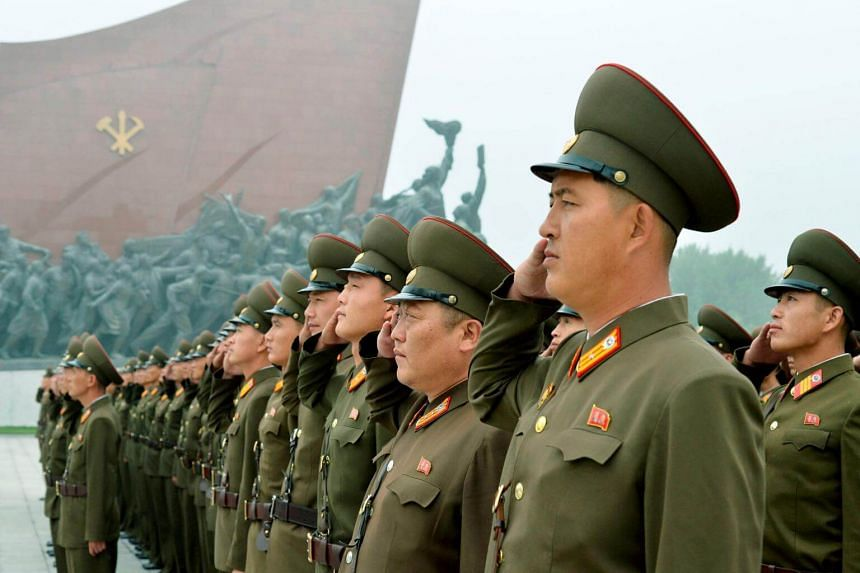 North Korean soldiers salute at Mansudae hill in Pyongyang, North Korea on the 69th founding anniversary of the country on Sept 9, 2017.