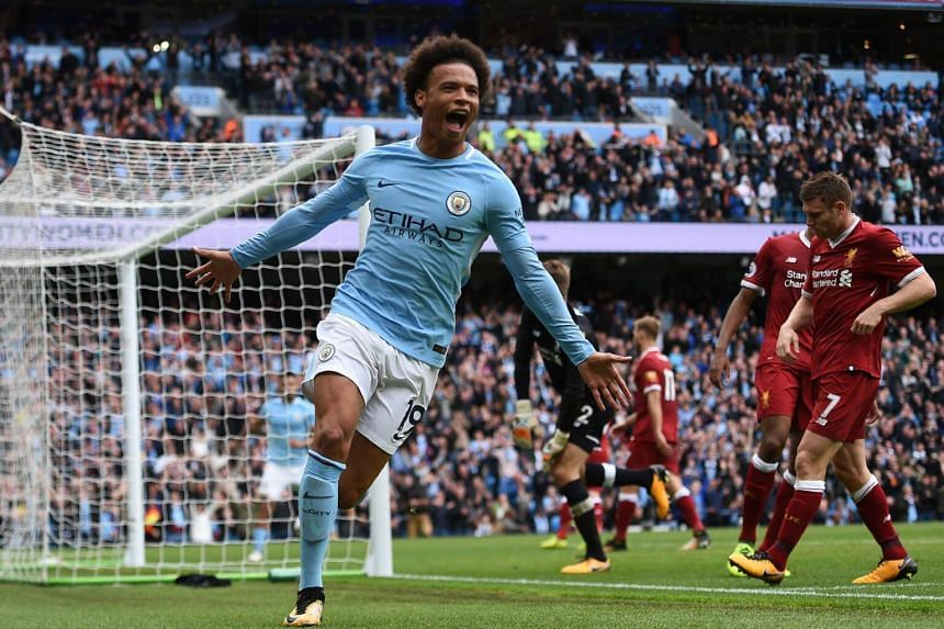 Manchester City's German midfielder Leroy Sane celebrates after scoring their fourth goal.