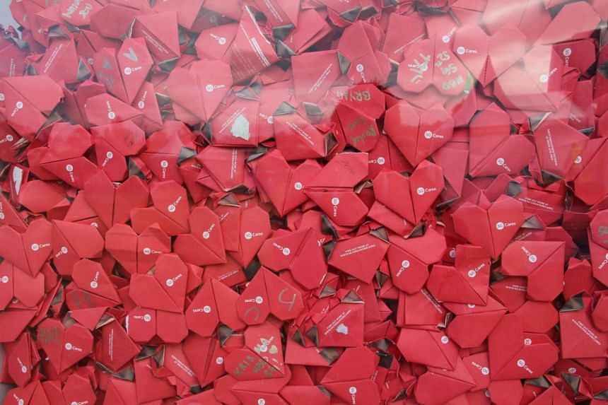 """Among the exhibits on display was a special installation, """"Hearts for Home"""". Made up of paper hearts folded by Singaporeans across Australia in Canberra, Sydney, Melbourne, Brisbane, Perth and Adelaide and Hobart."""
